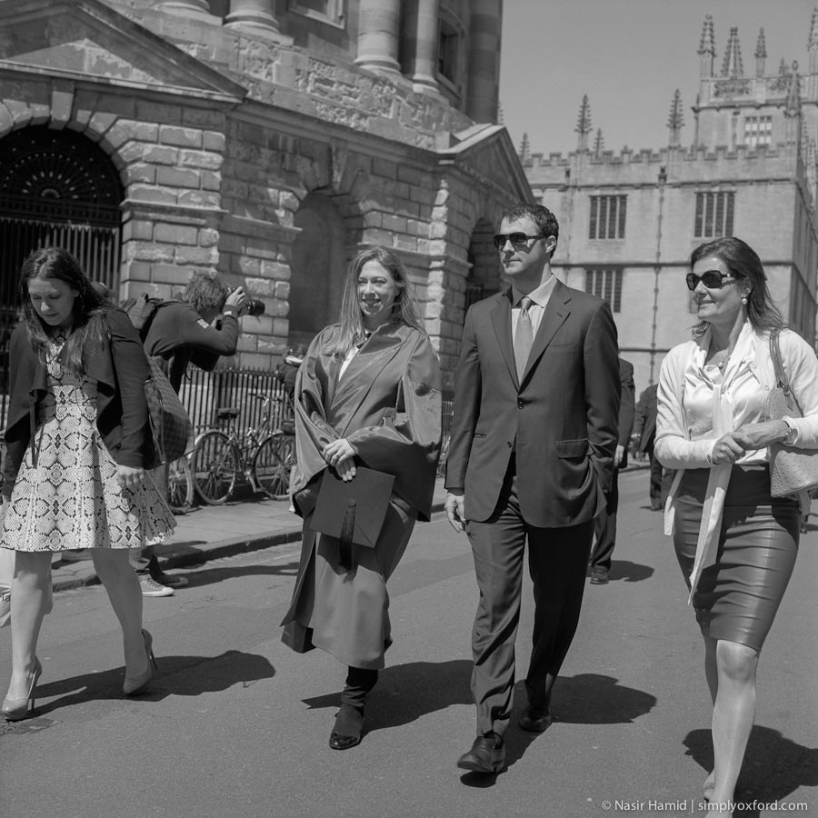 Chelsea Clinton and husband Marc walking in Radcliffe Square, Oxford